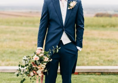 groom wearing traditional top and tails suit