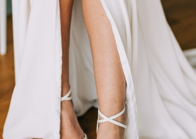 simple white wedding shoes with thin ankle straps