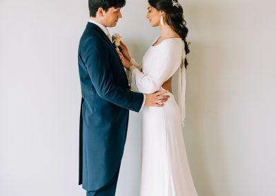 bride adjusting grooms tie