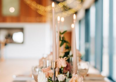 wedding table with tall peach candles