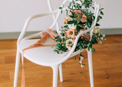 bridal bouquet on a white modern chair
