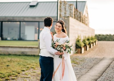 bride and groom standing outside casterley barn wedding venue