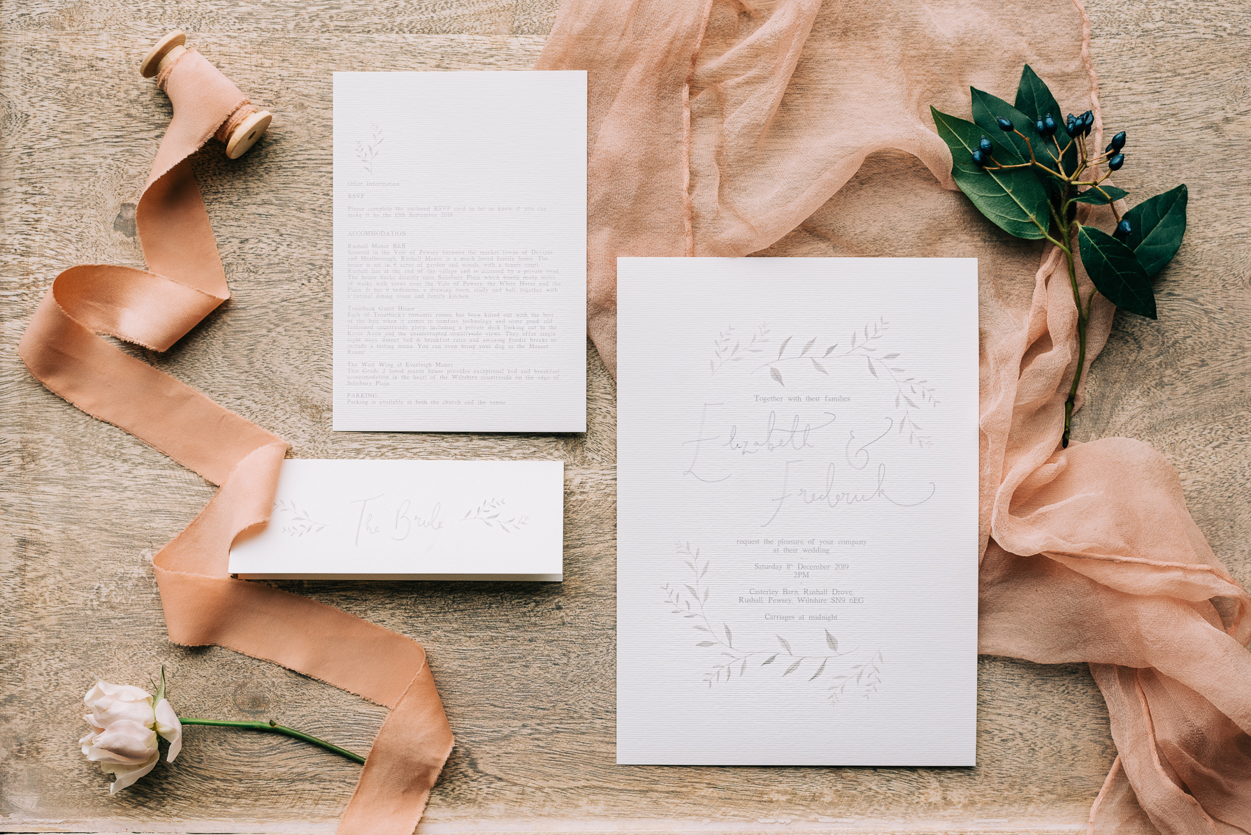 white wedding invites with pale peach silk ribbon